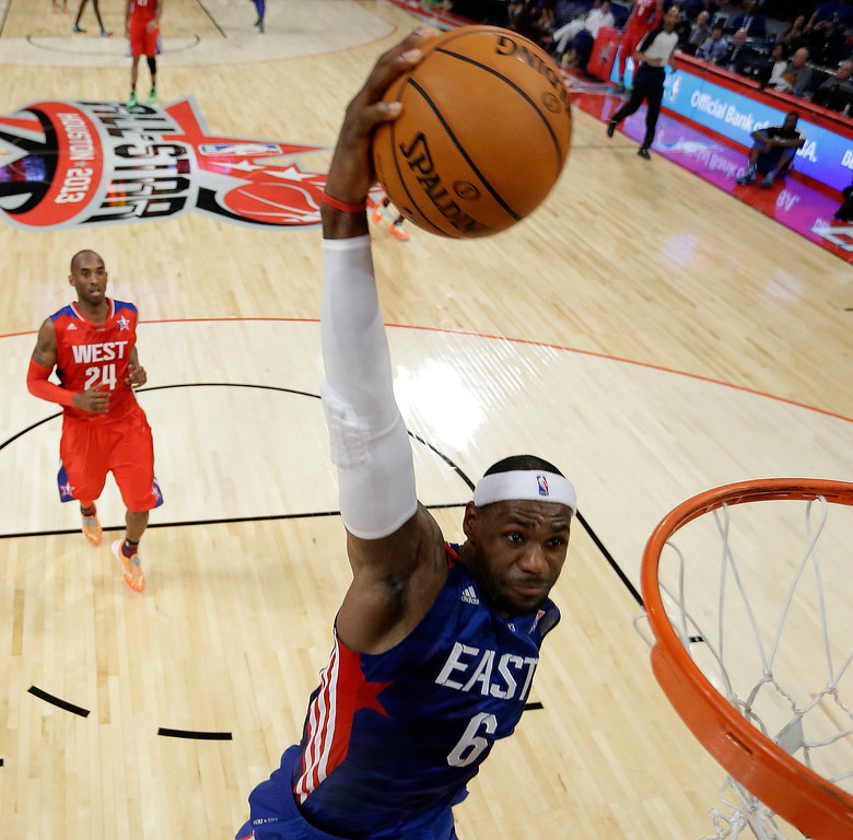 Description of . HOUSTON, TX - FEBRUARY 17:  LeBron James #6 of the Miami Heat and the Eastern Conference dunks the ball during the 2013 NBA All-Star game at the Toyota Center on February 17, 2013 in Houston, Texas. NOTE TO USER: User expressly acknowledges and agrees that, by downloading and or using this photograph, User is consenting to the terms and conditions of the Getty Images License Agreement.  (Photo by Eric Gay/Pool/Getty Images)