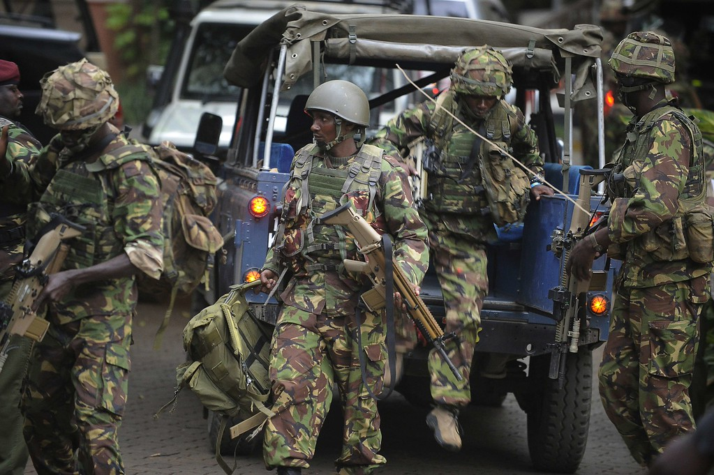 Description of . Soldiers from a special unit arrive outside the Westgate shopping mall in Nairobi, Kenya, on September 21, 2013.   AFP PHOTO / SIMON MAINA/AFP/Getty Images