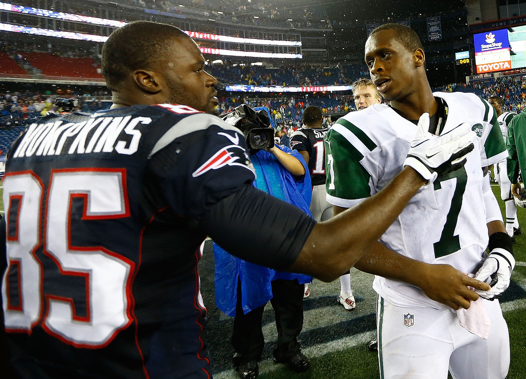 Description of . Geno Smith #7 of the New York Jets is greeted by Kenbrell Thompkins #85 of the New England Patriots following the Jets 10-13 loss during the game at Gillette Stadium on September 12, 2013 in Foxboro, Massachusetts. (Photo by Jared Wickerham/Getty Images)
