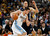 Denver Nuggets forward Danilo Gallinari, front, of Italy, works ball inside as Memphis Grizzlies forward Tayshaun Prince covers in the first quarter of an NBA basketball game in Denver, Friday, March 15, 2013. (AP Photo/David Zalubowski)