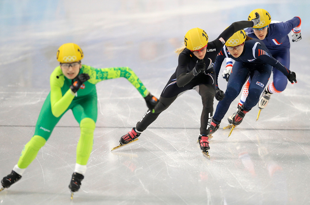 . From left, Agne Sereikaite of Lithuania, Emily Scott of the United States, Park Seung-hi of South Korea and Veronique Pierron of France compete in a women\'s 500m short track speedskating heat at the Iceberg Skating Palace during the 2014 Winter Olympics, Monday, Feb. 10, 2014, in Sochi, Russia. (AP Photo/Vadim Ghirda)