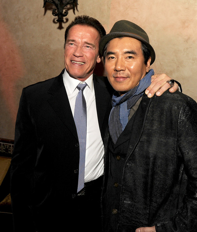 Description of . Actor Arnold Schwarzenegger (L) and director Jee-woon Kim pose at the after party for the premiere of Lionsgate Films'