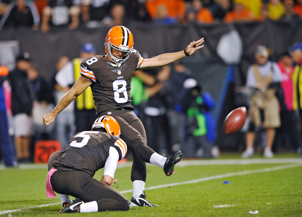 Description of . Cleveland Browns' Billy Cundiff (8) kicks a 24-yard field goal against the Buffalo Bills out of the hold of Spencer Lanning in the fourth quarter of an NFL football game Thursday, Oct. 3, 2013, in Cleveland. (AP Photo/David Richard)