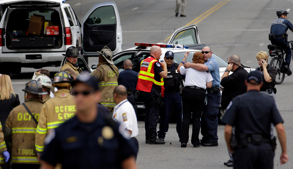 Description of . Police gather near the scene on Capitol Hill in Washington, Thursday, Oct. 3, 2013, after gunshots were heard. Police say the U.S. Capitol has been put on a security lockdown amid reports of possible shots fired outside the building.  (AP Photo/Alex Brandon)