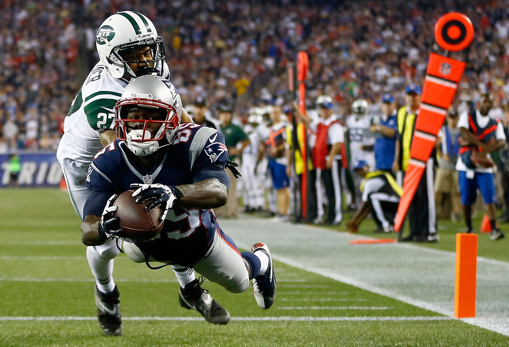 Description of . Wide receiver Kenbrell Thompkins #85 of the New England Patriots drops a pass in the endzone against cornerback Dee Milliner #27 of the New York Jets in the second quarter at Gillette Stadium on September 12, 2013 in Foxboro, Massachusetts.  (Photo by Jared Wickerham/Getty Images)