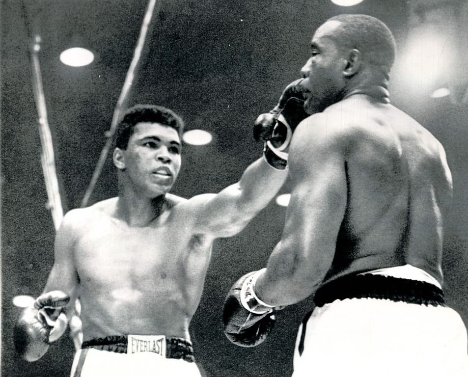 Description of . MIAMI BEACH, Fla., Feb.25, 1964--HIT AND RUN--Challenger Cassius Clay pokes a fast left jab to the face of Sonny Liston during their championship heavyweight fight in Miami Beach, Fla.  Clay used the in and out tactics to gain a TKO in the seventh round after Liston strained a shoulder and suffered a bad gash under the left eye.    Credit: AP
