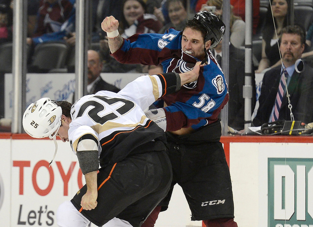 Description of . DENVER, CO. - FEBRUARY 06: Patrick Bordeleau (58) of the Colorado Avalanche and Brad Staubitz (25) of the Anaheim Ducks fight during the first period February 6, 2013 at Pepsi Center. The Colorado Avalanche take on the  Anaheim Ducks in NHL action. (Photo By John Leyba / The Denver Post)