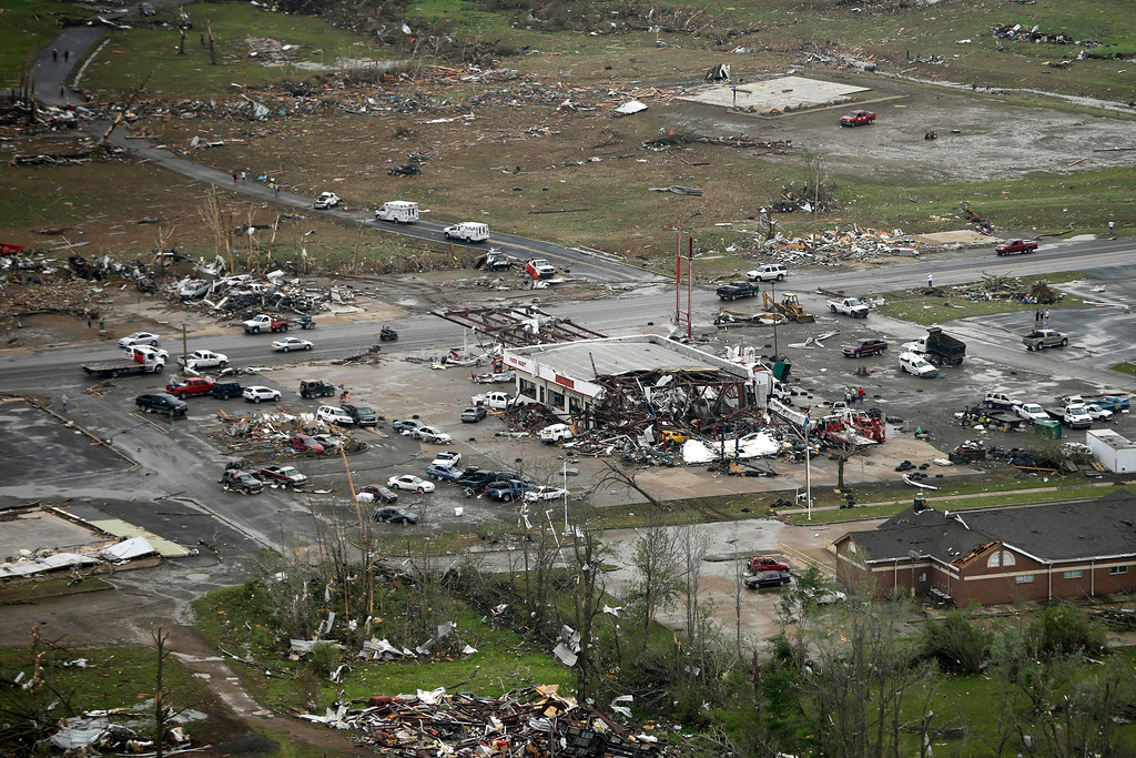 Description of . A storm-damaged convenience store, center, sits among rubble along U.S. Highway 64 in Vilonia, Ark., Monday, April 28, 2014, after a tornado struck the town late Sunday. (AP Photo/Danny Johnston)