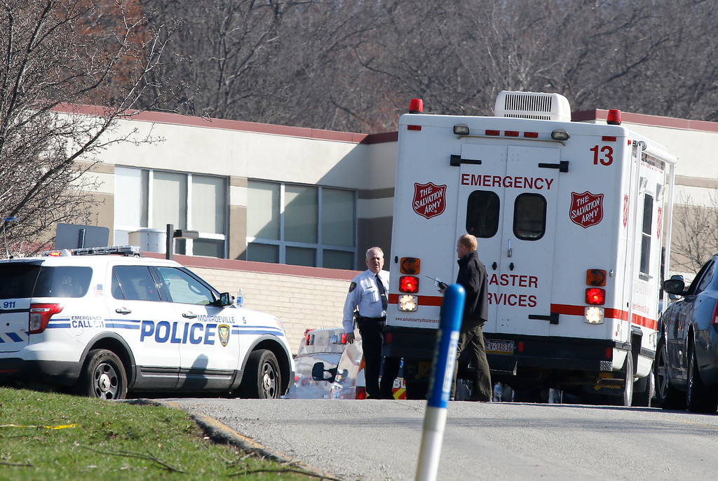 Description of . Emergency responders gather in the parking lot of the high school on the campus of the Franklin Regional School District where several people were stabbed at Franklin Regional High School on Wednesday, April 9, 2014, in Murrysville, Pa., near Pittsburgh. The suspect, a male student, was taken into custody and being questioned. (AP Photo/Keith Srakocic)