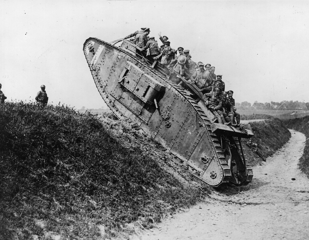 Description of . British soldiers enjoy a jaunt on a British Mark IV tank.   (Photo by Hulton Archive/Getty Images)