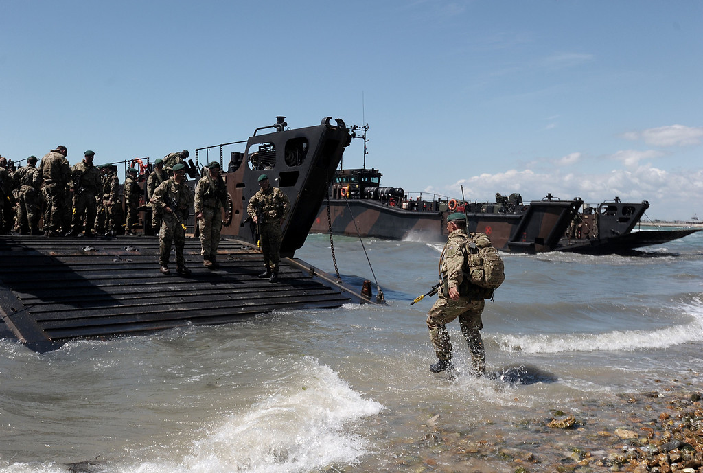 Description of . British Royal Marine Commandos demonstrate a beach landing a beach landing demonstration during D-Day commemorations in Portsmouth in southern England on June 5, 2014. Several hundred surviving veterans of the 1944 D-Day landings are commemorating the 70th anniversary of the mission on both sides of the English channel.  AFP PHOTO / CARL COURT/AFP/Getty Images