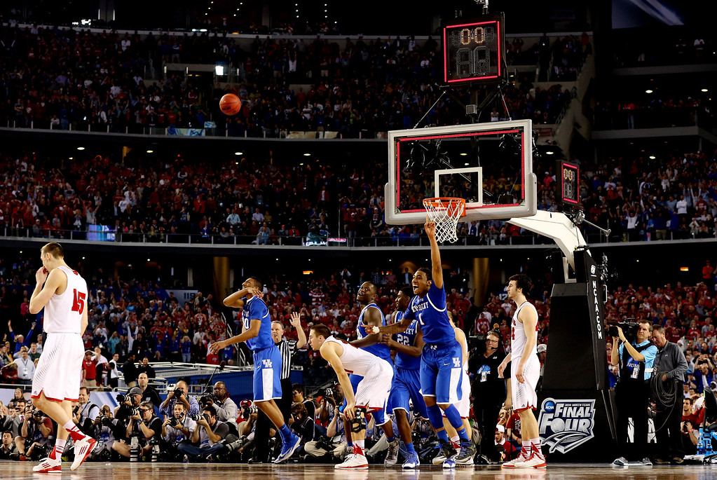Description of . ARLINGTON, TX - APRIL 05:  James Young #1 of the Kentucky Wildcats reacts after defeating the Wisconsin Badgers 74-73 in the NCAA Men's Final Four Semifinal at AT&T Stadium on April 5, 2014 in Arlington, Texas.  (Photo by Tom Pennington/Getty Images)