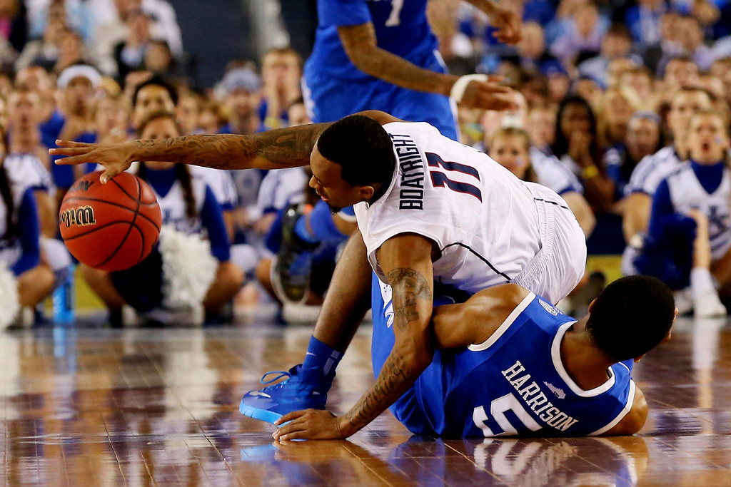 Description of . ARLINGTON, TX - APRIL 07: Ryan Boatright #11 of the Connecticut Huskies and Andrew Harrison #5 of the Kentucky Wildcats collide during the NCAA Men\'s Final Four Championship at AT&T Stadium on April 7, 2014 in Arlington, Texas.  (Photo by Ronald Martinez/Getty Images)