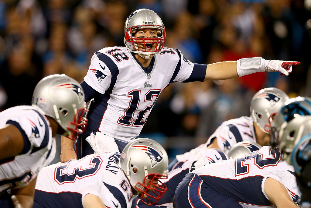 . Quarterback Tom Brady #12 of the New England Patriots calls out from under center in the first quarter against the Carolina Panthers at Bank of America Stadium on November 18, 2013 in Charlotte, North Carolina.  (Photo by Streeter Lecka/Getty Images)