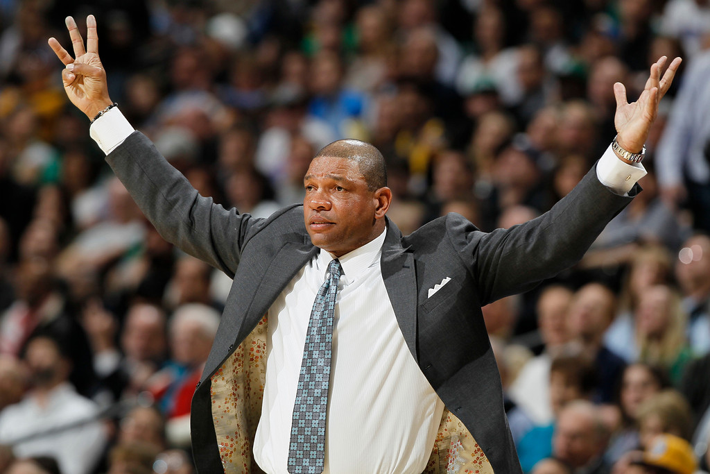 Description of . Boston Celtics coach Doc Rivers gestures to referees that the Celtics should be awarded three points on a shot against the Denver Nuggets in the third quarter of the Nuggets' 97-90 victory in an NBA basketball game in Denver on Tuesday, Feb. 19, 2013. (AP Photo/David Zalubowski)