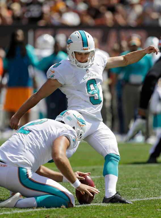 Description of . Miami Dolphins' Caleb Sturgis kicks a 45-yard field goal against the Cleveland Browns from the hold of Brandon Fields in the first quarter of an NFL football game Sunday, Sept. 8, 2013, in Cleveland. (AP Photo/Tony Dejak)