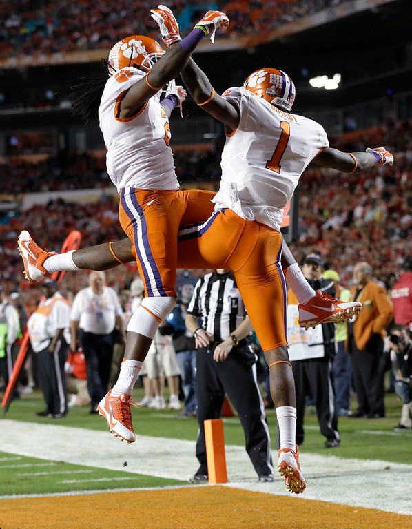 Description of . Clemson wide receiver Martavis Bryant  (1) celebrates with wide receiver Sammy Watkins, left, after scoring a touchdown during the first half of the Orange Bowl NCAA college football game against Ohio State, Friday, Jan. 3, 2014, in Miami Gardens, Fla. (AP Photo/Wilfredo Lee)