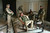 U.S. Army Stf. Sgt. Chad Touchett, center, relaxes with comrades from A Company, 3rd Battalion, 7th Infantry Regiment, following a search in one of Saddam Hussein's damaged palaces on April 7, 2003 in Baghdad. (AP Photo/John Moore)