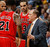 Chicago Bulls head coach Tom Thibodeau, right, confers with Jimmy Butler, front left, Taj Gibson, back left, and Joakim Noah during a time out against the Denver Nuggets in the second quarter of an NBA basketball game in Denver on Thursday, Feb. 7, 2013. (AP Photo/David Zalubowski)