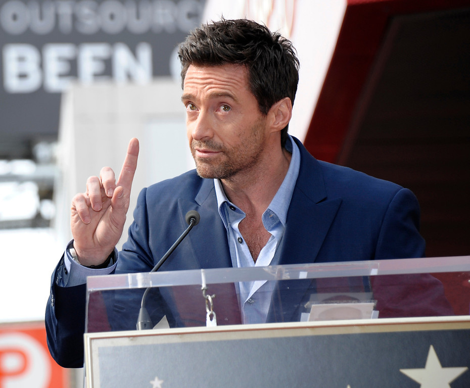 Description of . Actor Hugh Jackman speaks at his star ceremony at the Hollywood Walk of Fame on Thursday, Dec. 13, 2012, in Los Angeles. (Photo by Dan Steinberg/Invision/AP)