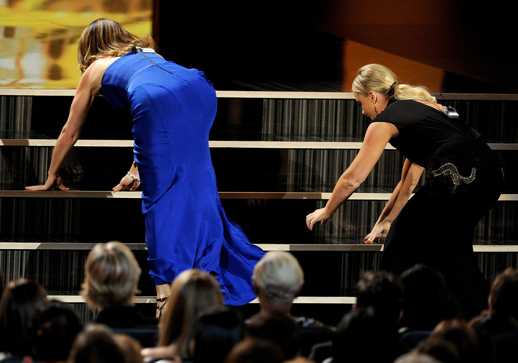 Description of . Writer/actresses Tina Fey (L) and Amy Poehler speak onstage during the 65th Annual Primetime Emmy Awards held at Nokia Theatre L.A. Live on September 22, 2013 in Los Angeles, California.  (Photo by Kevin Winter/Getty Images)