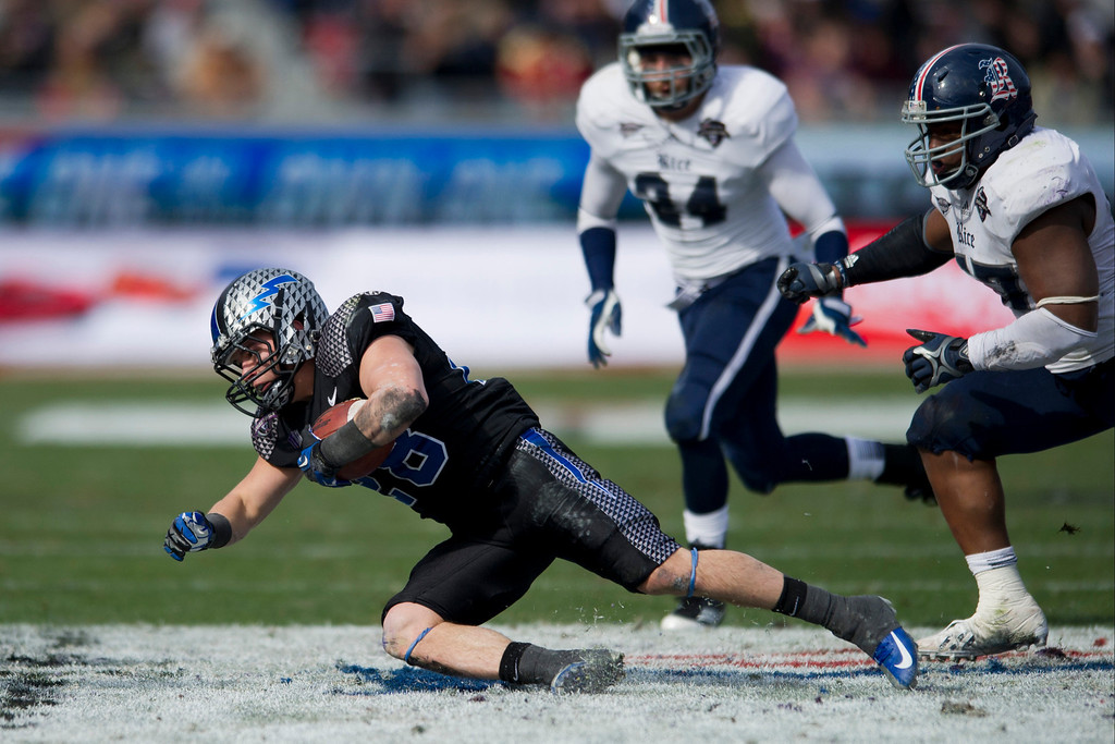 Description of . Cody Getz #28 of the Air Force Falcons dives for extra yards against the Rice Owls on December 29, 2012 during the Bell Helicopter Armed Forces Bowl at Amon G. Carter Stadium in Fort Worth, Texas.  (Photo by Cooper Neill/Getty Images)