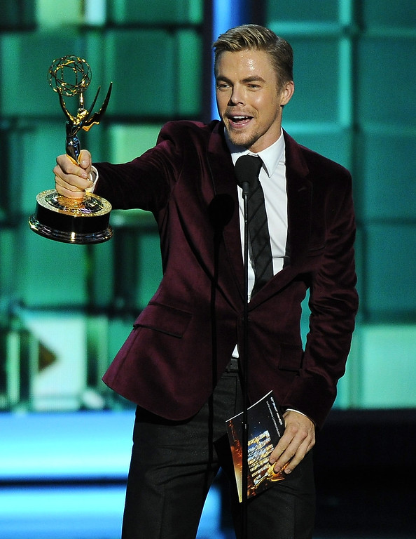 Description of . Derek Hough accepts the award for outstanding choreography for his work on ìDancing with the Starsî at the 65th Primetime Emmy Awards at Nokia Theatre on Sunday Sept. 22, 2013, in Los Angeles.  (Photo by Chris Pizzello/Invision/AP)