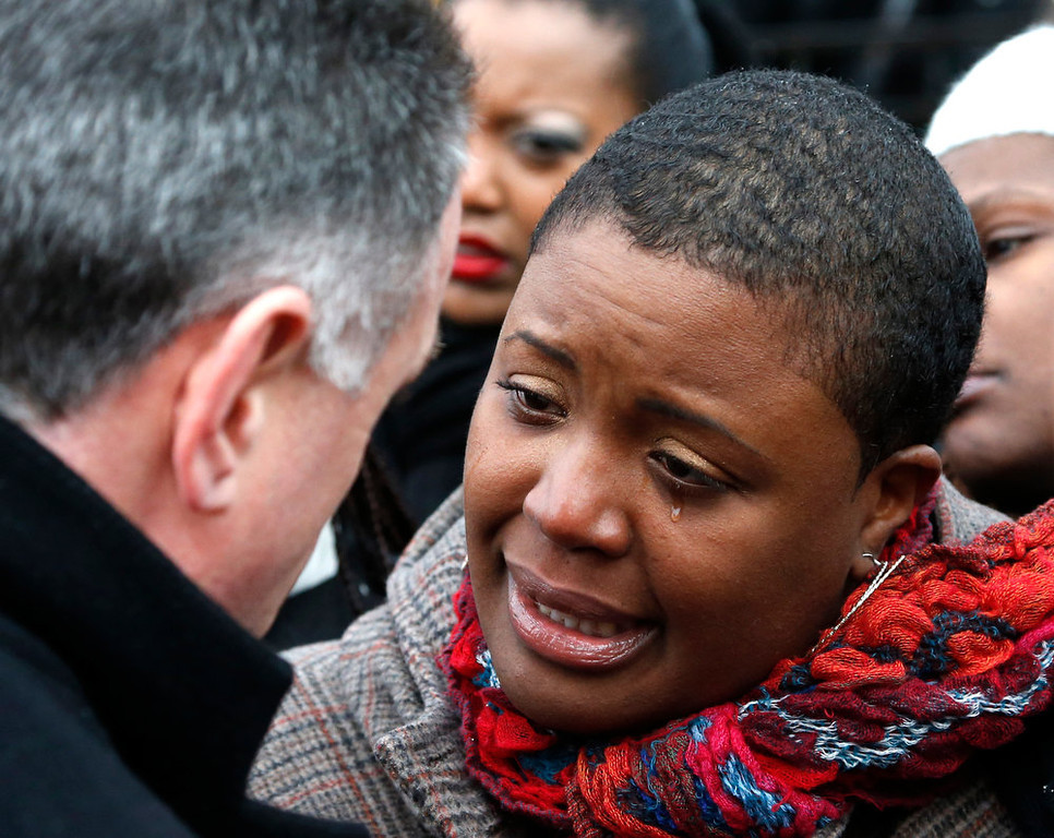 Description of . Cleopatra Pendelton cries as she talks with Chicago Police Superintendent Garry McCarthy before a news conference seeking help from the public in solving the murder of Pendelton's daughter Hadiya Wednesday, Jan. 30, 2013, in Chicago. Hadiya, 15, who had performed in President Barack Obama's inauguration festivities, was killed in a Chicago park as she talked with friends by a gunman who apparently was not even aiming at her. The city's 42nd slaying is part of Chicago's bloodiest January in more than a decade, following on the heels of 2012, which ended with more than 500 homicides for the first time since 2008. It also comes at a time when Obama, spurred by the Connecticut elementary school massacre in December, is actively pushing for tougher gun laws. (AP Photo/Charles Rex Arbogast)