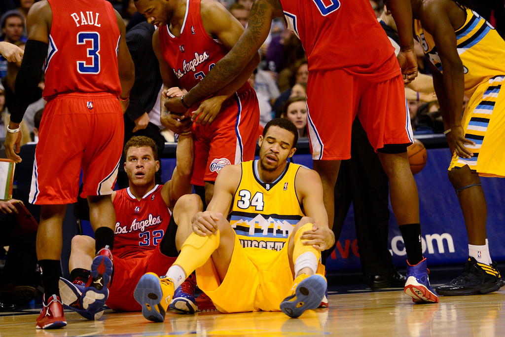 Description of . Denver Nuggets center JaVale McGee (34) sits on the ground after fouling Los Angeles Clippers power forward Blake Griffin (32) during the first half at the Pepsi Center on Tuesday, January 1, 2013. AAron Ontiveroz, The Denver Post