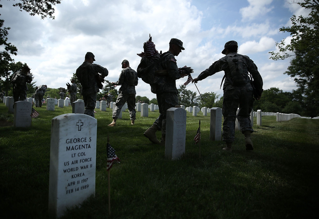 """Description of . Members of the Fife and Drum Corps of the 3rd U.S. Infantry Regiment, \""""The Old Guard,\"""" participate in a \""""Flags-In\"""" ceremony May 23, 2013 at Arlington National Cemetery in Arlington, Virginia.   (Photo by Alex Wong/Getty Images)"""