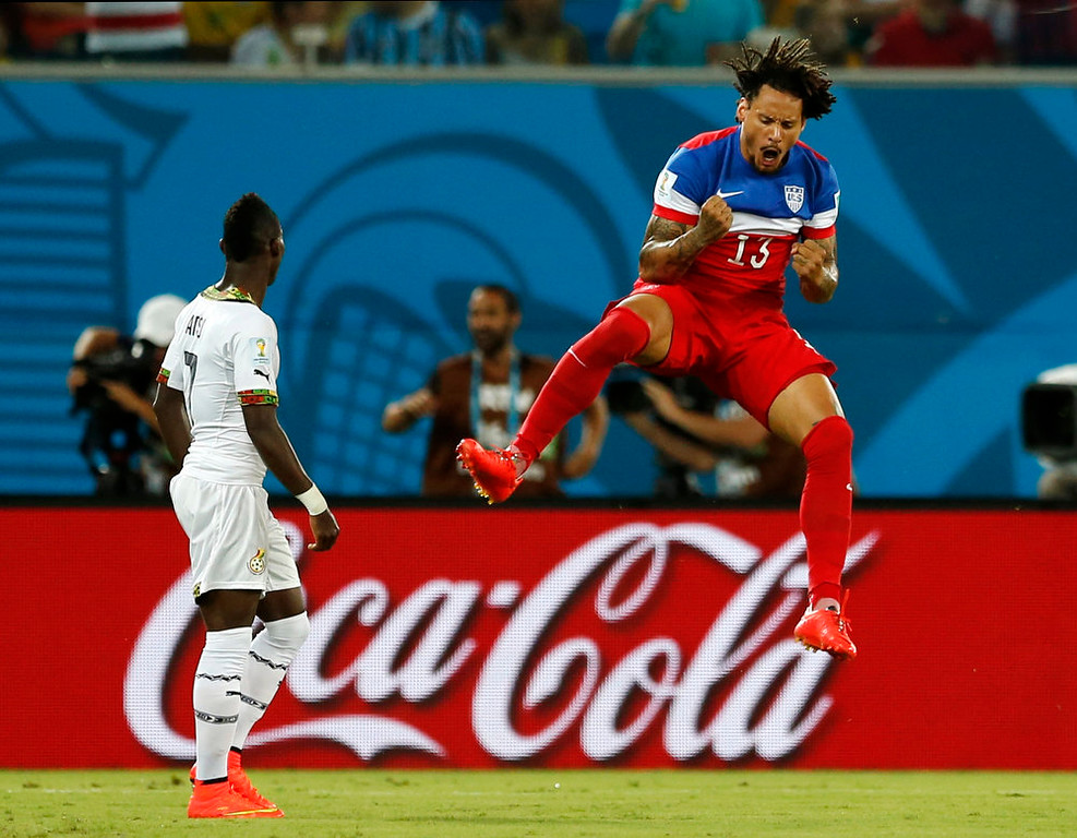 Description of . Ghana's Christian Atsu, left, looks back at his net as United States' Jermaine Jones celebrates a goal by Clint Dempsey during the group G World Cup soccer match between Ghana and the United States at the Arena das Dunas in Natal, Brazil, Monday, June 16, 2014. (AP Photo/Julio Cortez)