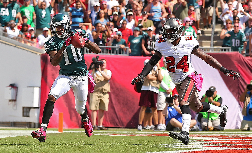 Description of . DeSean Jackson #10 of the Philadelphia Eagles catches a touchdown pass over Darrelle Revis #24 of the Tampa Bay Buccaneers during a game  at Raymond James Stadium on October 13, 2013 in Tampa, Florida.  (Photo by Mike Ehrmann/Getty Images)
