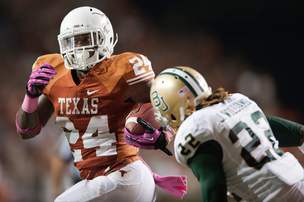 Description of . AUSTIN, TX - OCTOBER 20:  Joe Bergeron #24 of the Texas Longhorns breaks free during the Big 12 Conference game against the Baylor University Bears on October 20, 2012 at Darrell K Royal-Texas Memorial Stadium in Austin, Texas.  (Photo by Cooper Neill/Getty Images)