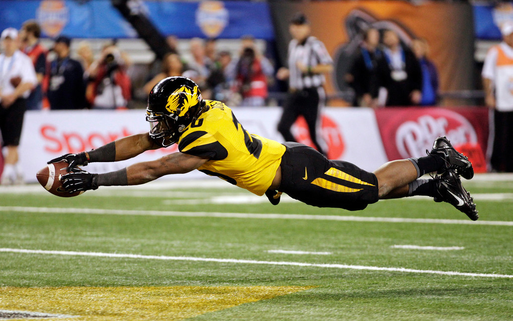 Description of . Missouri running back Henry Josey (20) goes in for a touchdown against Oklahoma State during the second half of the Cotton Bowl NCAA college football game on Friday, Jan. 3, 2014, in Arlington, Texas.  (AP Photo/Tim Sharp)