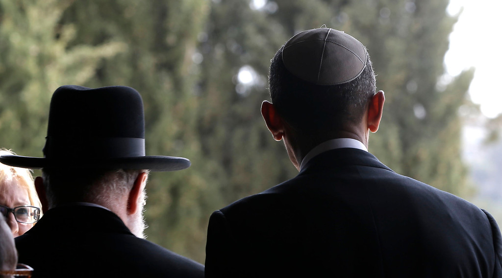 Description of . U.S. President Barack Obama, right, walks out with Rabbi Meir Lau, left, after visiting the Hall of Remembrance at the Vad Vashem Holocaust Memorial in Jerusalem, Israel, Friday, March 22, 2013. (AP Photo/Pablo Martinez Monsivais)