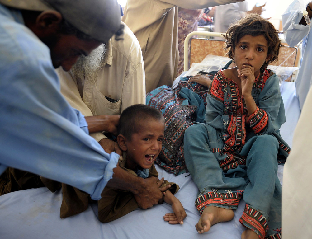 Description of . Pakistani child survivors are treated in makeshift hospital in the earthquake-devastated district of Awaran on September 25, 2013.    AFP PHOTO/Banaras  KHAN/AFP/Getty Images