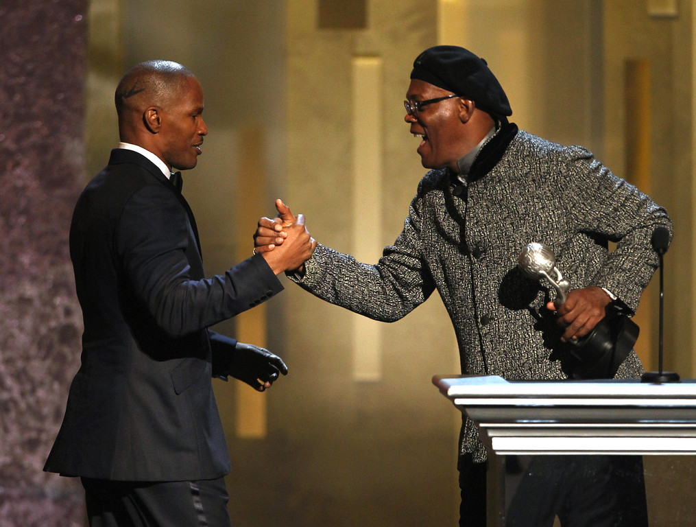 Description of . Samuel L. Jackson, right, presents the award for entertainer of the year to Jamie Foxx at the 44th Annual NAACP Image Awards at the Shrine Auditorium in Los Angeles on Friday, Feb. 1, 2013. (Photo by Matt Sayles/Invision/AP)