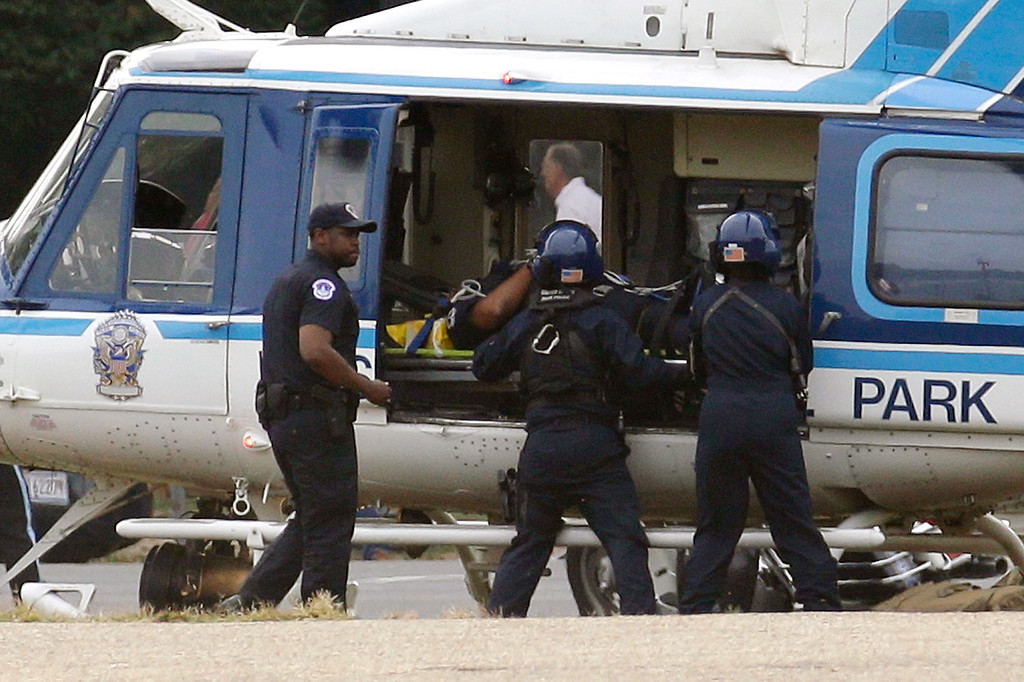 Description of . A U.S. Park Police helicopter is loaded on the Mall in Washington, Thursday, Oct. 3, 2013, with a victim from a shooting. Police say the U.S. Capitol has been put on a security lockdown amid reports of possible shots fired outside the building.  (AP Photo/Alex Brandon)