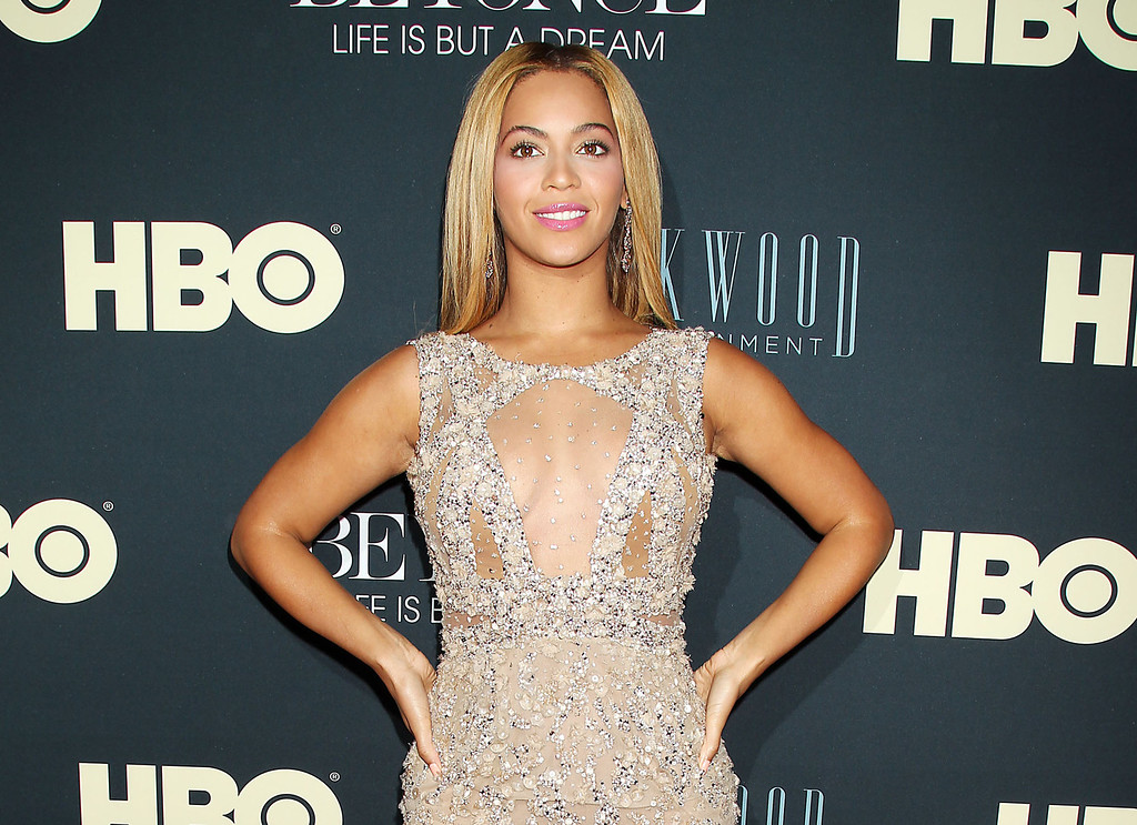 Description of . This image released by Starpix shows Beyonce at the premiere of her HBO documentary
