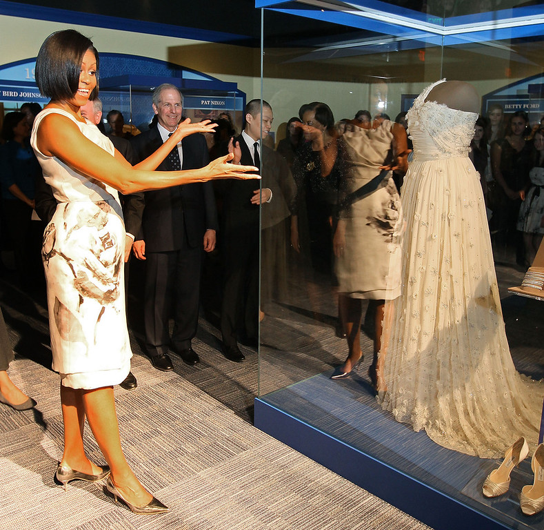 Description of . First lady Michelle Obama looks at the inaugural gown she wore to the inaugural balls and is now on display at the Smithsonian Museum of American History on March 9, 2010 in Washington, DC. Mrs. Obama continues a long tradition of first ladyís who have donated their inaugural gown to be on display at the Smithsonian.  (Photo by Mark Wilson/Getty Images)