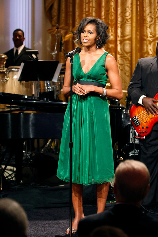 Description of . This Feb. 25, 2009 file photo shows first lady Michelle Obama hosting 'Stevie Wonder In Performance at the White House: The Library of Congress Gershwin Prize' in the East Room of the White House in Washington. (AP Photo/Gerald Herbert,File)