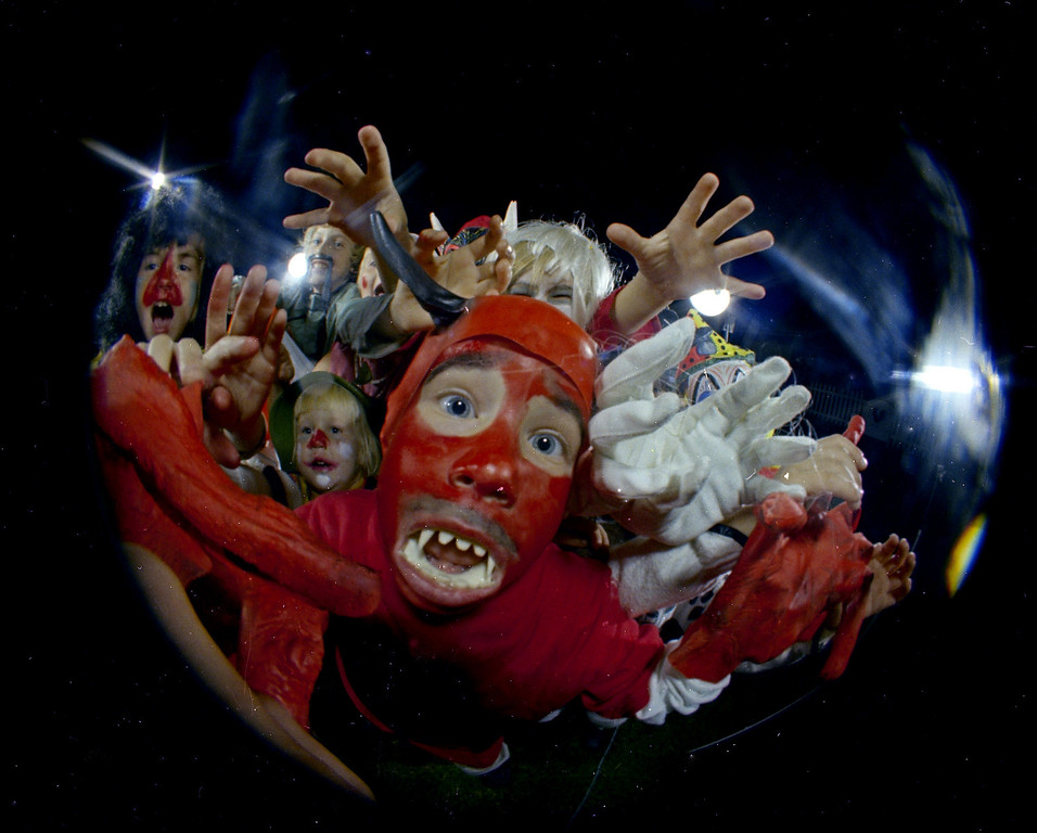 Description of . Kids in Halloween costumes are seen through a fisheye lens, Oct. 31, 1966. Location is unknown. (AP Photo)