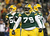 (C) Defensive end Ryan Pickett #79 of the Green Bay Packers reacts in front of teammates inside linebacker A.J. Hawk #50 and nose tackle B.J. Raji #90 in the second quarter against the Minnesota Vikings during the NFC Wild Card Playoff game at Lambeau Field on January 5, 2013 in Green Bay, Wisconsin.  (Photo by Andy Lyons/Getty Images)