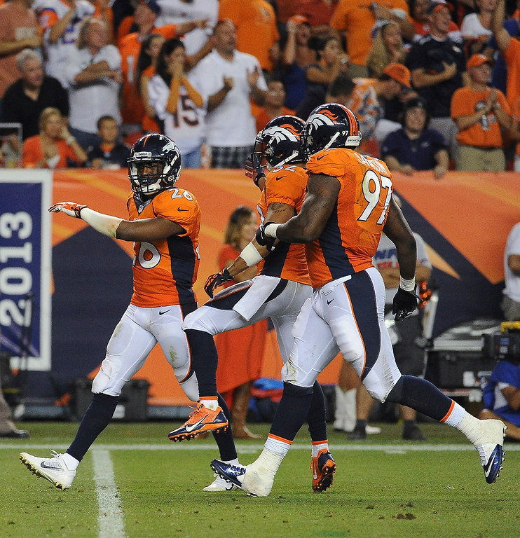 Description of . Denver Broncos free safety Rahim Moore (26) struts after stoppong a pass play during the third quarter. Denver Broncos vs Baltimore Ravens September 5, 2013 at Sports Authority at Mile High. (Photo by Tim Rasmussen/The Denver Post) /The Denver Post)
