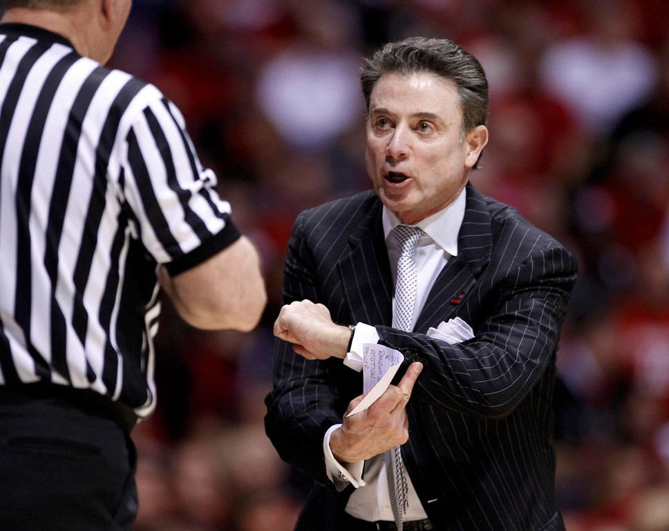 Description of . Louisville Cardinals head coach Rick Pitino argues with an official during his team's game against the Duke Blue Devils during their Midwest Regional NCAA men's basketball game in Indianapolis, Indiana, March 31, 2013. REUTERS/Matt Sullivan