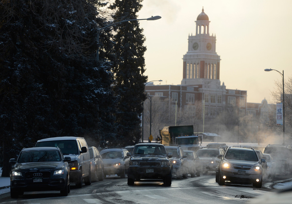 Description of . Cars and trucks idle waiting to cross York St. at 18th Ave in below zero temperatures Wednesday morning, February 05, 2014. (Photo By Andy Cross / The Denver Post)