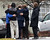 Mourners embrace as they leave the Honan Funeral Home, where the family of six-year-old Jack Pinto is holding his funeral service, in Newtown, Connecticut December 17, 2012. Pinto was one of the 20 students killed in the December 14 shootings at Sandy Hook Elementary School in Newtown. REUTERS/Mike Segar