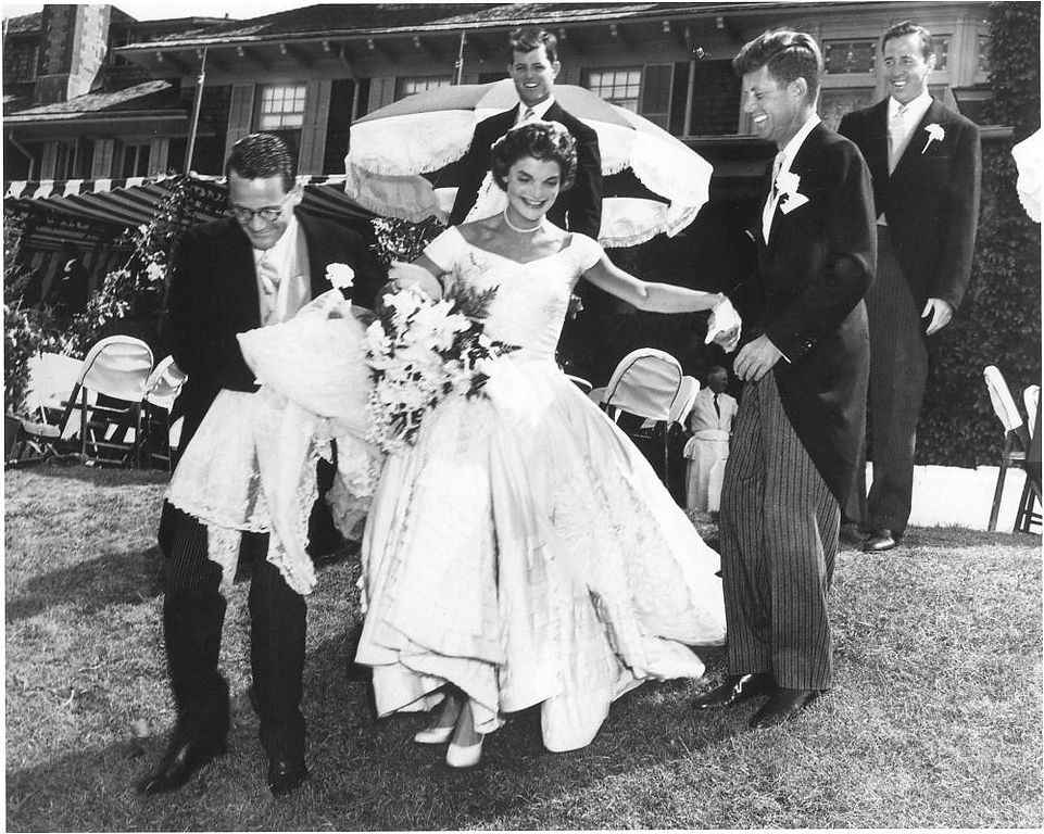 Description of . Jacqueline Bouvier Kennedy and Sen.  John F. Kennedy celebrate during their wedding reception at Hammersmith Farm, Newport, R.I., on Sept. 12, 1953.
