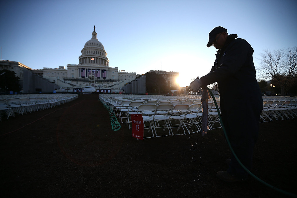 Description of . A worker prepares to wipe down chairs, set up in front of the U.S. Capitol Building on January 20, 2013 in Washington, DC. Washington is preparing for the second inauguration of U.S. President Barack Obama, which will take place on January 21.  (Photo by Mark Wilson/Getty Images)
