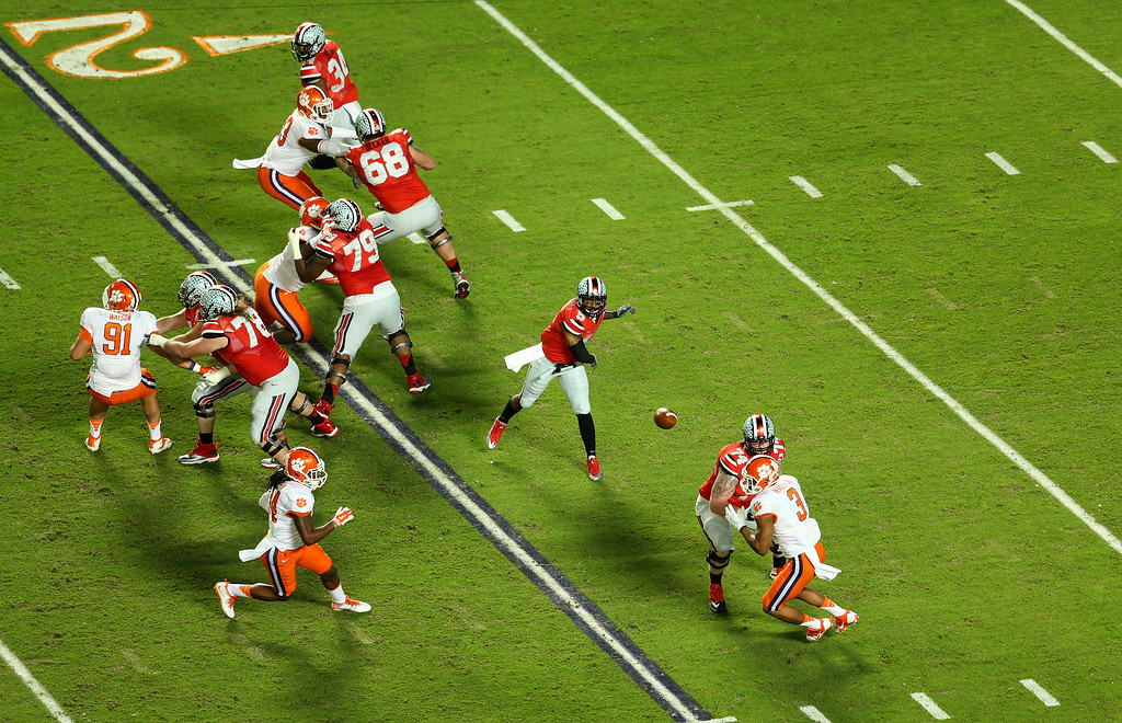 Description of . MIAMI GARDENS, FL - JANUARY 03: Braxton Miller #5 of the Ohio State Buckeyes passes in the first quarter against the Clemson Tigers during the Discover Orange Bowl at Sun Life Stadium on January 3, 2014 in Miami Gardens, Florida.  (Photo by Mike Ehrmann/Getty Images)